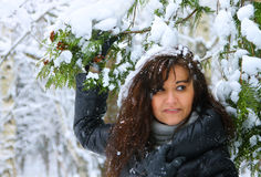 Young woman in a winter forest Royalty Free Stock Photography