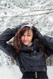 Young woman in a winter forest Royalty Free Stock Photos