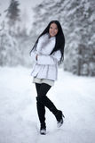 Young woman in winter forest Royalty Free Stock Image