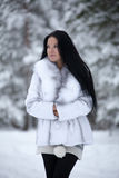 Young woman in winter forest Stock Image