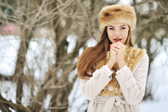 Young woman in winter with hands next to her face - close Royalty Free Stock Photography