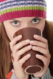 Young woman in winter hat with cup Royalty Free Stock Photos