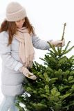 Young woman in winter holds a fresh Christmas tree. royalty free stock photos