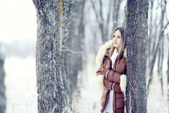 Young woman in winter jacket Stock Images