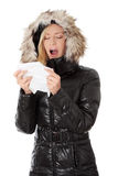 Young woman in winter jacket holding tissue Royalty Free Stock Images