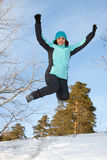 A young woman in the winter jump Stock Image