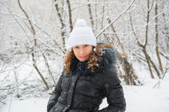 Young woman in winter knitted white hat Stock Images