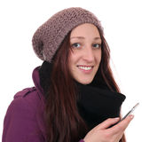 Young woman in winter making a call with a smartphone or mobile Royalty Free Stock Images