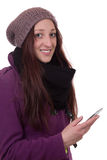 Young woman in winter with a mobile phone Royalty Free Stock Photography