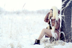 Young woman in winter nature Stock Photo