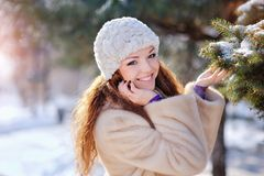 Young woman at winter in park Royalty Free Stock Photos