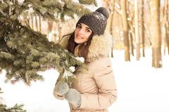 Young woman in winter park. Happy young woman in winter park enjoy her life Royalty Free Stock Photo