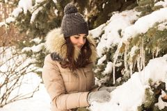 Young woman in winter park. Happy young woman in winter park enjoy her life Royalty Free Stock Images