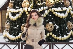 Young woman in winter park near christmas tree Stock Photography