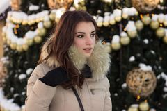 Young woman in winter park near christmas tree Stock Image