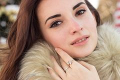 Young woman in winter park near christmas tree Royalty Free Stock Images