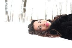 A young woman in a winter park. Outdoor Stock Image