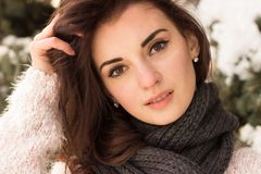 Young woman in winter park. Portrait of woman in winter park near the winter tree Stock Image