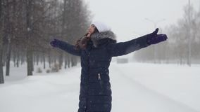 Young woman in winter park. Walks in the open air.  stock footage