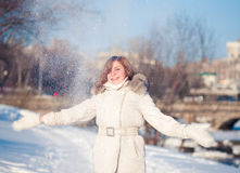 Young woman winter portrait. Young beautiful woman playing with snow. Shallow dof Royalty Free Stock Photo