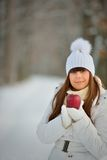 Young woman winter portrait with apple Royalty Free Stock Photography