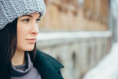 Young woman winter portrait. Beautiful Young Smiling Girl in her Winter Warm Clothing. Royalty Free Stock Photos