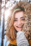 Young woman winter portrait. Close-up portrait of happy girl. Expressing positivity, true brightful emotions.  royalty free stock images