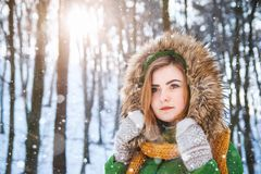 Young woman winter portrait. Close-up portrait of happy girl. Expressing positivity, true brightful emotions.  royalty free stock photo