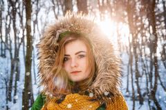 Young woman winter portrait. Close-up portrait of happy girl. Expressing positivity, true brightful emotions.  stock photography