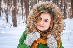 Young woman winter portrait. Close-up portrait of happy girl. Expressing positivity, true brightful emotions.  stock photo