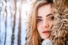 Young woman winter portrait. Close-up portrait of happy girl. Expressing positivity, true brightful emotions.  stock image
