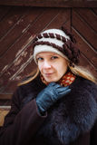 Young woman winter portrait with hat, brown coat and black leather gloves, outdoor Stock Photography