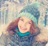 Young woman in winter, smiling Stock Images