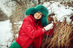 The young woman in the winter in snow Stock Images