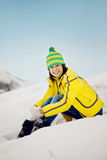 The young woman in the winter in snow Stock Image
