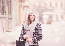 Young woman winter snowing looking above. Up. Winter fashion stylish clothes scarf, coat, hat Stock Photos