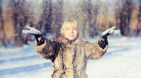 Young woman in the winter snowy scenery Royalty Free Stock Photography