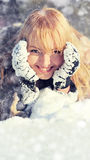 Young woman in the winter snowy scenery Royalty Free Stock Photo