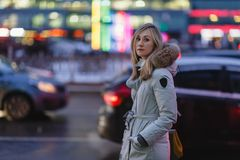 Young woman in the winter street. stock image