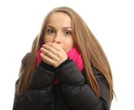 Young woman in winter tries to warm up her hands royalty free stock image