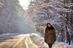 Young woman on a winter walk. Sunny winter day Royalty Free Stock Photography
