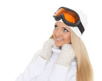 Young woman  in winter warm clothes and ski glasses. Stock Image