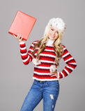 Young woman in winter wear holding a box Stock Images