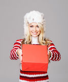 Young woman in winter wear holding a red box Royalty Free Stock Photo