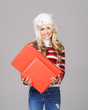 Young woman in winter wear holding a red box Stock Photo