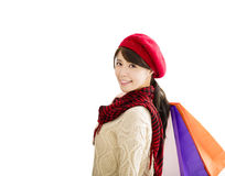Young woman with winter wear and shopping bags Royalty Free Stock Images