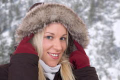 Young woman in winter wearing a fur collar Royalty Free Stock Photo