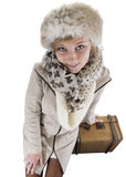 Young woman in winterclothes with suitcases, isolated on white Royalty Free Stock Image