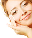 Young woman wipes a face skin Royalty Free Stock Images