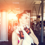 Young woman wiping her body after training in gym Stock Photography